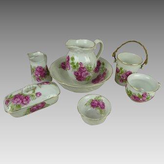 Sweet original antique French flowered porcelain toilette/wash set, 7 pieces