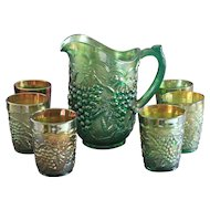 Large Green Carnival Glass Pitcher and 6 Matching Glasses
