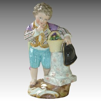 Antique Meissen Youth with Flower Basket