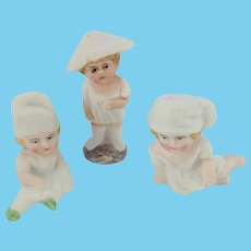 Set of Three Adorable  Bisque Cake Decorations. Figures of Children.