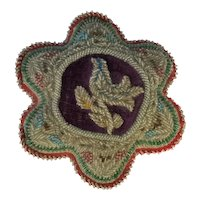 A Victorian Beadwork Cushion. Exotic Bird. C. 1890