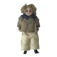 German Originally Dressed All Bisque Boy Doll. C1900.
