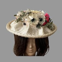 1950's Cream Cellophane Straw Hat With Colorful Silk Flowers By Sheppard Of New York