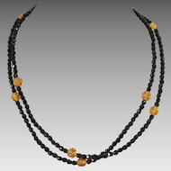 Single Strand Black and Amber Colored Bead Necklace