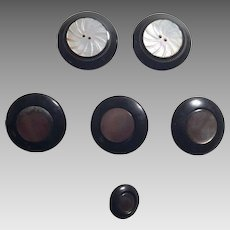 Group Of Six Black Plastic and Mother Of Pearl Buttons
