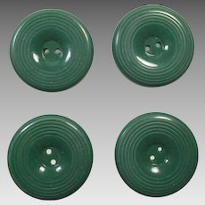 Four Kelly Green Carved Bakelite Buttons
