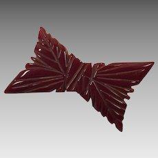 Bakelite Carved Bow Pin Dark Burgundy Wine