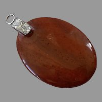 Large Oval Red Jasper Pendant With Decorative Bail