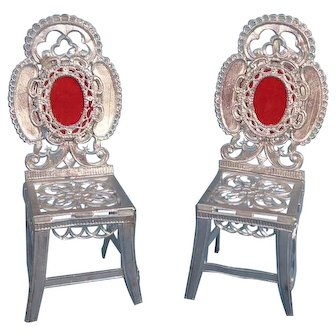 Vintage dolls house soft metal chairs.