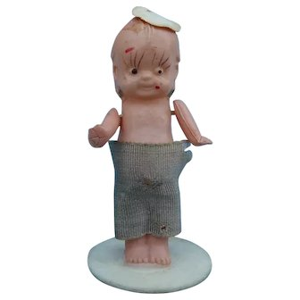 Vintage tiny celluloid kewpie doll.