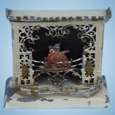 Vintage dolls house tin and soft metal metal fireplace.