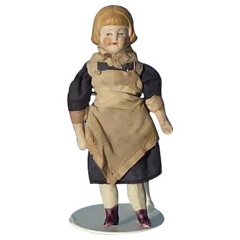 Vintage dolls house maid in original clothes.
