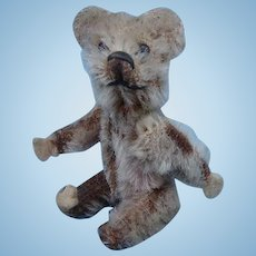 Vintage VERY SMALL jointed teddy bear.