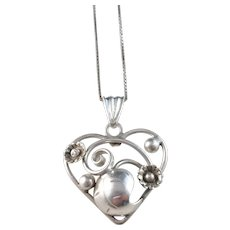 Per Ericsson, Sweden year 1951 Mid Century Solid Silver Flower Heart Pendant Necklace.