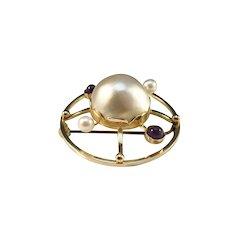 Örnsköldsvik, Sweden Year 1947 Mid Century 18k Gold Large Mabe Pearl, Cultured Pearl and Amethyst Brooch. Excellent.