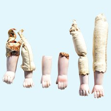 Lot T – 6 Antique Bisque and Leather Doll Arms