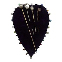 An Early 20thC Blue Velvet  Heart Pincushion + Hatpins