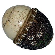 A Rare Napoleonic Prisoner of War Bone and Beaded Egg Containing Miniature Bone Dominoes Circa 1800