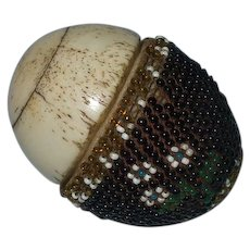 A Rare Napoleonic Prisoner of War Bone and Beaded Egg Containing Miniature Bone Dominoes Circa 1800