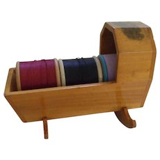 A Charming 19th Century Mauchline ware Thread Spool Cradle