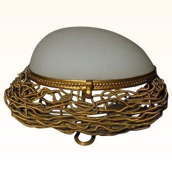 A 19th Century French Opaline Egg Trinket Box on Gilt Wirework Nest