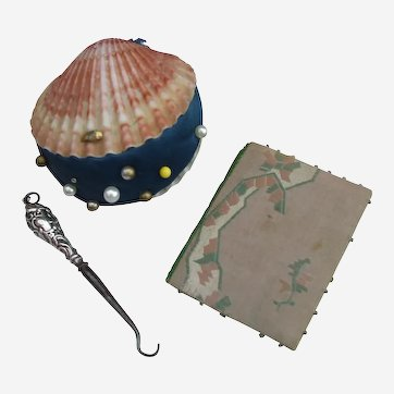 A !9th Century Shell Pincushion, Silk Needlecase/Pinholder and Miniature Buttonhook