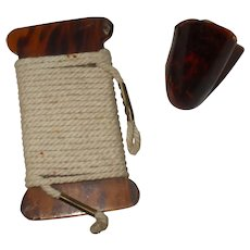 A Faux Tortoiseshell Thread Winder and Finger Guard