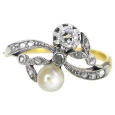 Edwardian Crossover natural pearl diamonds ring, circa 1910