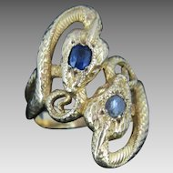 A stunning French two snakes crossover ring with sapphire and diamond, c.1880, Victorian ring