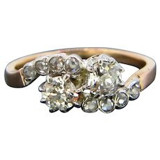 Antique Toi et Moi Crossover Old Mine Diamonds Ring, circa 1910, 18kt gold and platinum, France