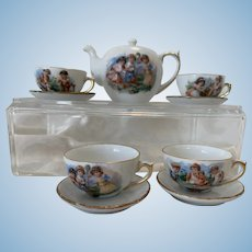 Adorable Antique tea set with children playing