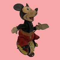 Wonderful Marx Mickey Mouse on unicycle.