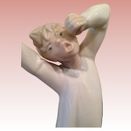 Mint Lladro Yawning and stretching boy