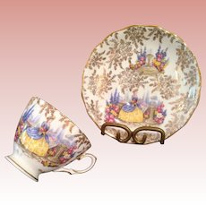 Vintage cup & saucer with Lady in Garden