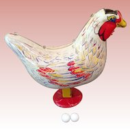 Vintage Wyandotte Tin Hen Laying eggs