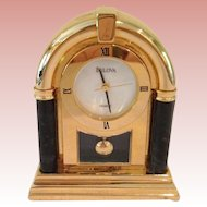 Vintage miniature Bulova brass clock