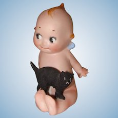 Rose O'Neill Bisque Sitting Kewpie with Black Cat