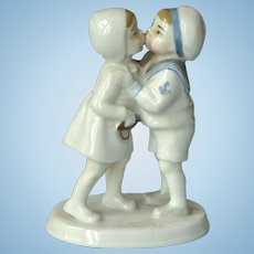 Small Porcelain Figurine of a Boy Sailor Kissing a Girl