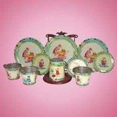 Cute Tin Child's Tea Set with Children