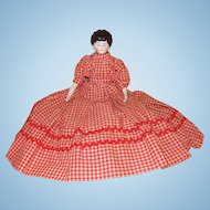 German China Head Doll Wearing a Red Gingham Dress
