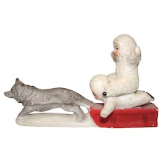 Bisque Snow Babies on a Sled with Dog