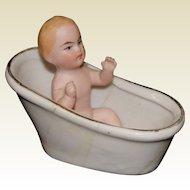 Miniature German All Bisque Baby Sitting in a Porcelain Bath Tub