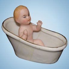 Miniature German All Bisque Baby Sitting in a Porcelain Bath Tub