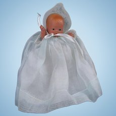 Nancy Ann Storybook Baby Doll Wearing an Organdy Gown