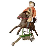 Wonderful Antique Mechanical Wind-up Toy Horse and Bisque Head Rider
