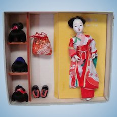 Boxed Japanese Doll with Three Wigs, Bag and Shoes