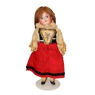 Cute Little Bisque Head Child Doll in Regional Costume