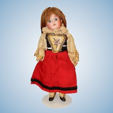 Cute Little Bisque Head Child Doll in Regional Costume