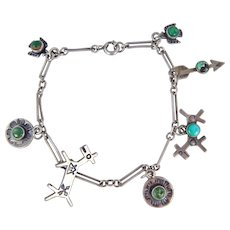 Navajo - Fred Harvey Era Sterling Silver and Turquoise Charm Bracelet C. 1930-40s.