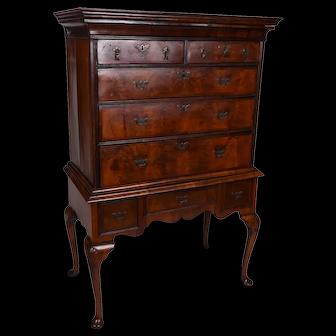A Queen Anne figured walnut chest on stand